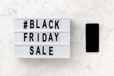 Creative top view flat lay promotion composition with Black friday sale text on lightbox. Template banner online shopping sale mockup