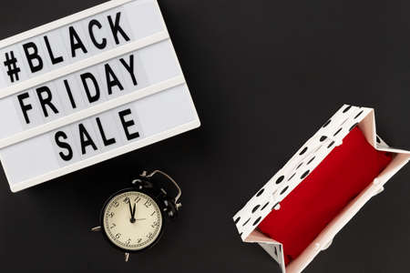 Creative top view flat lay promotion composition with Black friday sale text on lightbox. Template banner shopping sale mockup 免版税图像 - 155974605