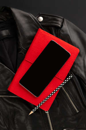 Creative flat lay top view composition with jacket, smartphone and note pad 免版税图像 - 155555322