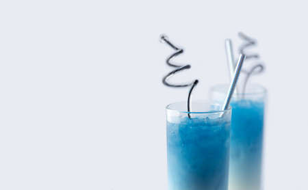 Summer refreshing beverage blue butterfly pea latte in glass on white background
