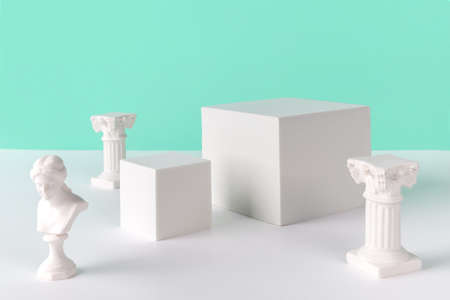Abstract background mock up with podium for product display and gypsum ancient sculpture. Blank product stand in minimal slyle on turquoise background.