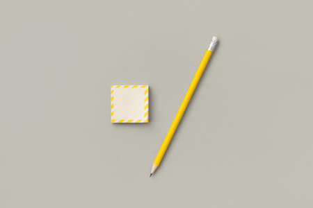Yellow stickers with pencil on gray background.