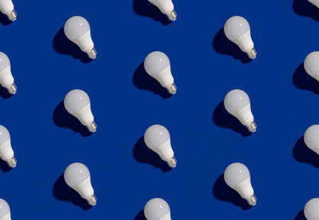 Pattern with LED energy saving light bulbs on blue background