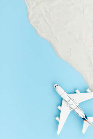 Creative composition with toy airplane and sand 免版税图像