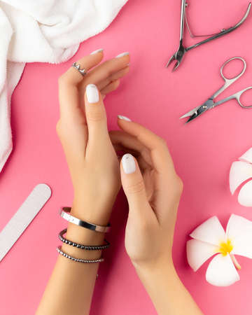 Womans hands with trendy white french manicure 免版税图像