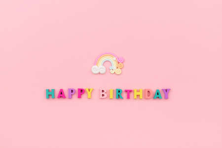 Happy birthday inscription from wooden colorful letters with rainbow