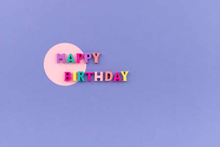 Happy birthday text from wooden colorful letters
