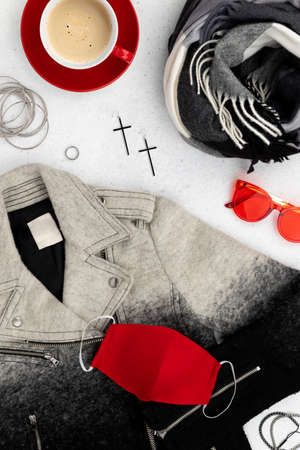 Womens clothes and accessories on gray background 免版税图像
