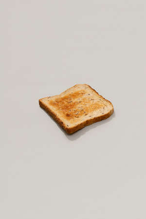 Fresh toasted bread on gray background with sunlight