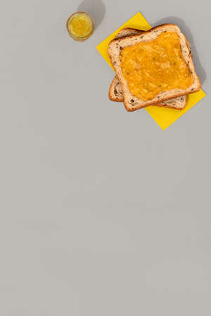 Toast with lemon jam on gray background 免版税图像