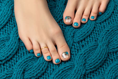 Manicure, pedicure beauty salon concept. Womans feet on white background Stock Photo