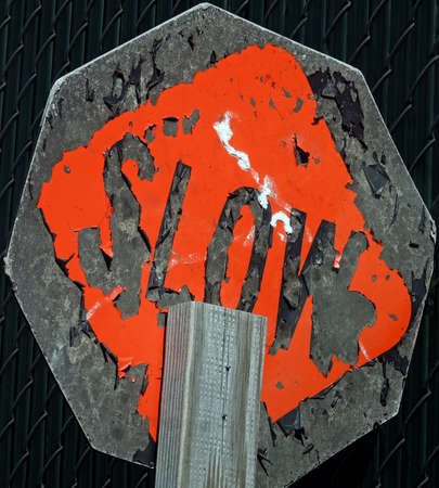 slow: Damaged and tilted handmade SLOW sign