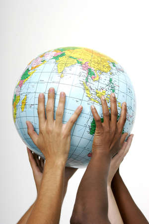lifting globe: Hands holding up a globe, on white background  Stock Photo