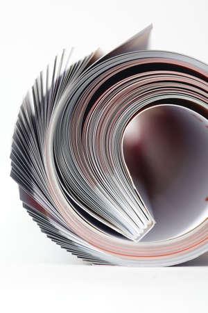 Magazine roll on white background  photo