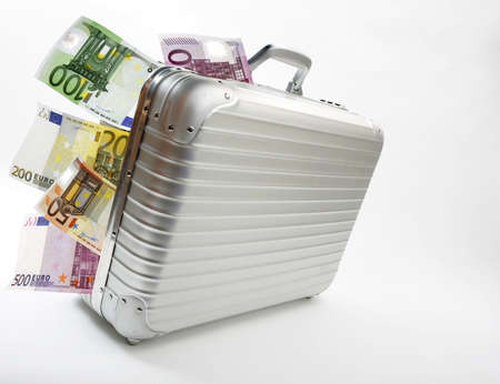 Suitcase with Euro banknotes, isolated on white background