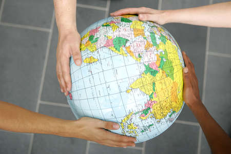 People holding a globe  photo