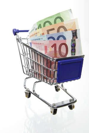 Mini shopping cart with euro banknotes on white background Stock Photo - 8823522