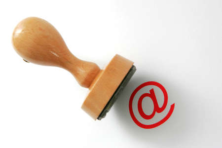 Wooden rubber stamp with at- Sign 스톡 사진