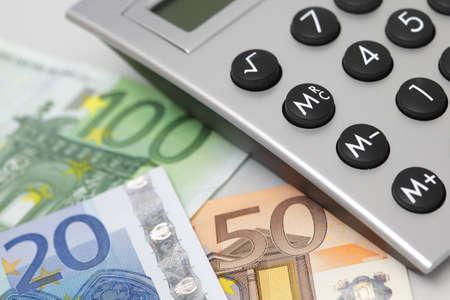 desktop calculator, closeup with euro currency  photo