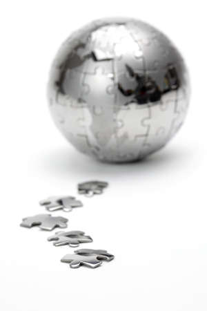Metal puzzle globe isolated on white background photo