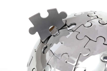 complexity: Metal puzzle globe close-up,  isolated on white background