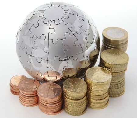 Metal puzzle globe with euro coins on white background  photo