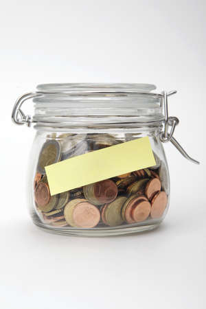 Euro coins in a glass jar