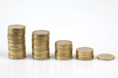 euro coins stacked up in a row, isolated on white background Stock Photo - 9257714