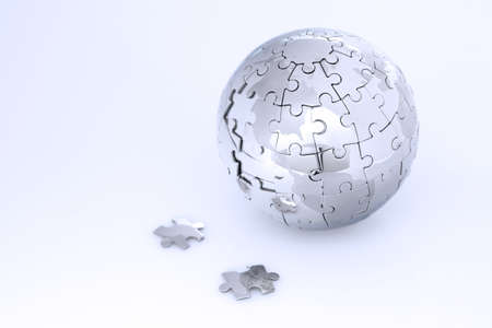 Metal puzzle globe isolated on white background, in blue light