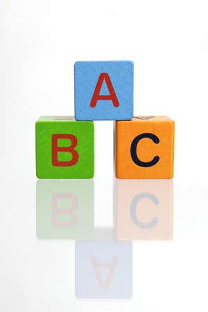 ABC wooden blocks stacked on white background Stock Photo - 9320011