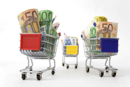 Mini shopping carts with euro banknotes on white background Stock Photo - 9320043