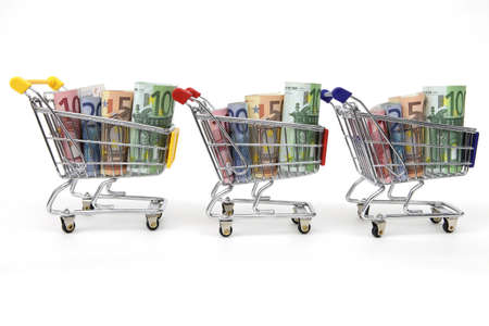 Mini shopping carts with euro banknotes in a row on white background Stock Photo - 9320039