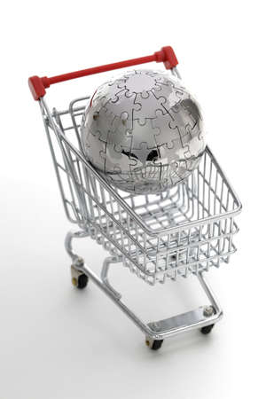 Metal puzzle globe with shopping cart, isolated on white background photo