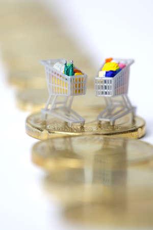 Miniature shopping carts on Euro coins  Stock Photo - 9320040