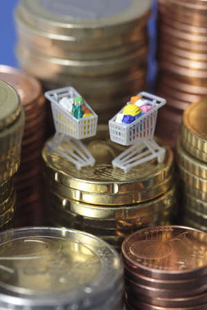 Miniature shopping carts on top of euro coin stack Stock Photo - 9320056