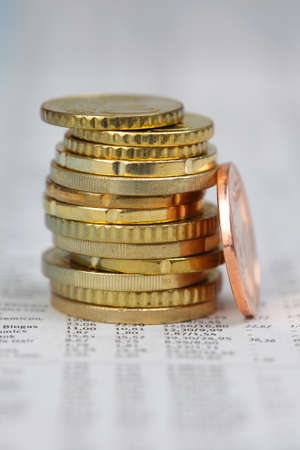 Stack of Euro coins on financial Newspaper photo