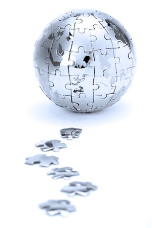 Metal puzzle globe isolated on white background, in blue light  photo
