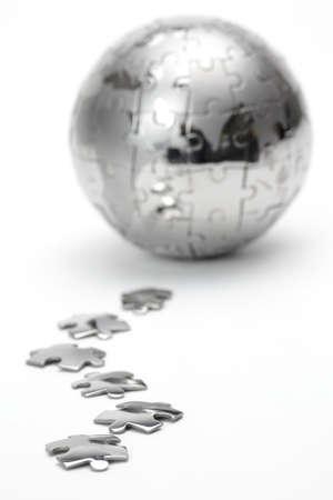Metal puzzle globe isolated on white background Stock Photo
