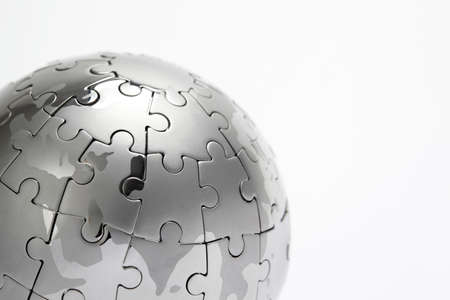 Metal puzzle globe close-up,  isolated on white background Stock Photo - 9353877