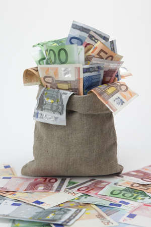 Bag of money with different euro bills 스톡 사진
