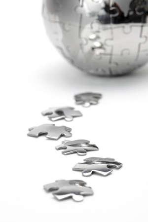 Metal puzzle globe close-up,  isolated on white background photo