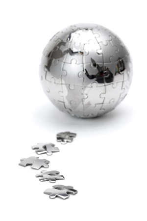 Metal puzzle globe isolated on white background Stock Photo