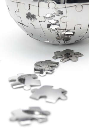 Metal puzzle globe close-up,  isolated on white background