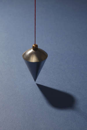 perpendicular: Vertical plumb on blue background Stock Photo