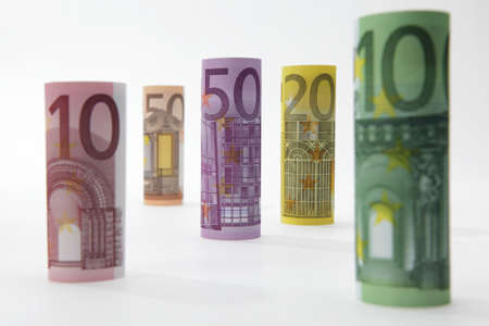 Rolled up Euro bills on white background Stock Photo - 9375168