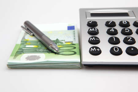 Calculator with euro bills and pen photo