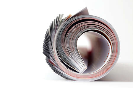 Magazine roll on white background  Stock Photo