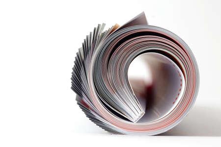 Magazine roll on white background Stock Photo - 9617893