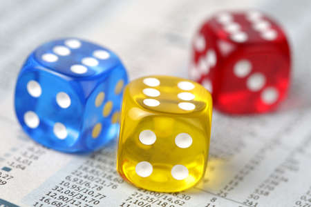 odds: Colorful dice on financial report Stock Photo