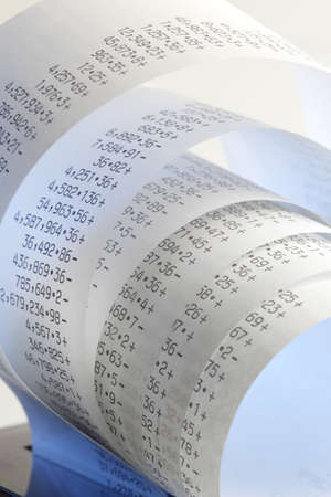 financial controller: Calculator paper tape rolled up